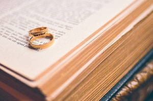 "The Essence of CovenantRecently, I participated in a conversion about divorce in the church. While many attribute marital difficulties to communication or the lack thereof, I was of the opinion that a failure to understand the essence of covenant was at the heart of divorce.Covenant is word we often find when studying the Bible or discussing biblical theology. We may reference the new covenant or the old covenant. We may talk about the covenant between God and Abraham or God and 	Moses. We refer to the New Testament as being under the new covenant, but what exactly is a covenant and 	what does it mean to you in this modern age?The first thing to understand about covenant is that it was created by God to be holy. It is not to be taken lightly and should only be entered into with the full understanding of its sacred requirements.God holds the sanctity of covenant above nearly all other things. It is covenant that is at the center of our salvation through Christ. It is covenant that defines Christ's death on the cross. It is the fulfillment of covenant that has redeemed mankind and brought him back to his creator.The English language fails us in many ways when we use it to understand scriptures. Our understanding of covenant is a good example. In Hebrew, the word for covenant means both covenant and testament. This means for us, that we may freely exchange those two English words. For example, the Old Testament and the New Testament are the old covenant and the new covenant and vice-versa.If we are to understand the essence of covenant, we need an English phrase to encompass its true meaning. The phrase ""binding-agreement-upon-death"" comes fairly close.In English, we separate the words covenant and testament with two separate meanings. The English definition for a covenant is an agreement. The English definition for testament is a document or a statement which commonly comes into effect upon death.This is how we come to the phrase, last will and testament. At the reading of a will, the final wishes of a deceased person is read aloud and carried out. The testament therefore becomes effective only after the person's death. This is the critical component of a covenant – to enter into covenant, a death is required! There is no way around this. If you do not have a death, you cannot enter into covenant.When we combine these two English definitions, we come close to the essence of God's covenant – a binding agreement that becomes effective upon death.The first time we see covenant in scripture is when God enters into covenant with Abram in Genesis Chapter 15.Gen 15:9 ""And he said unto him, Take me an heifer of three years old, and a she goat of three years old, and a ram of three years old, and a turtledove, and a young pigeon.""Gen 15:10 ""And he took unto him all these, and divided them in the midst, and laid each piece one against another: but the birds divided he not.""In verse nine, God tells Abram to gather together a heifer, a goat, and a ram. He then has Abram sacrifice the animals and cut their carcasses into two halves by dividing them.Later in verses 17-18 we see the Spirit of God pass between the animal carcass halves and enter into a covenant with Abram.Gen 15:17 ""And it came to pass, that, when the sun went down, and it was dark, behold a smoking furnace, and a burning lamp that passed between those pieces.""Gen 15:18  ""In the same day the LORD made a covenant with Abram, saying, Unto thy seed have I given this land, from the river of Egypt unto the great river, the river Euphrates:""What we're seeing in these verses is the creation of covenant. By passing between the halves of the sacrificed animals, God has ""sealed"" His agreement with Abram with death. That is the essence of covenant – a binding agreement upon death.We see this act of covenant again when God asks Abraham to sacrifice his son Isaac. Though God stays Abraham's hand at the last second, in his heart Abraham fulfilled his responsibility to God by sacrificing his son. Upon this act, Abraham entered into a new covenant with God.God fulfills His responsibility to this new covenant with Abraham by sacrificing His son Jesus on the cross. Upon Jesus' death, the new covenant or New Testament goes into effect. Again, we see that a covenant is a binding agreement upon death.The application of a covenant is a solemn and holy act in which God places great importance. Throughout the history of the nation of Israel, God holds the sanctity of covenant above all other agreements and considers the breaking of covenant one of the greatest sins. When did God unleash His wrath upon Israel? When she broke her covenant with God and worshiped false gods and idols.The covenant between God and Israel is like a spiritual marriage. The new covenant is like a marriage too with Jesus as the bride groom and the church as the bride. A marriage between a man and woman is a mirror image of God's covenant and so, marriage is much more than just vows. It is a holy commitment that binds two people in a covenant that becomes effective upon death, but what death? – the death of self.The essence of covenant in marriage is to give up your life, or to die to yourself, so that your life becomes your spouses'. From the moment you enter into a covenant of marriage, your life is no longer yours but now belongs to your spouse for you have died to yourself. This is the death that seals a marriage in covenant.While I agree with those that say communication is important to a marriage, I believe it is a failure to understand the essence of covenant that is at the heart of the divorce rate we see in the church."